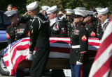 The color-guard carries the casket of Navy Hospital Corpsman 2nd Class Charles Luke Milam at Ft....