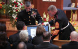 Marines present Michael and Rita Milam awards and tributes to their so,  Navy Hospital Corpsman...