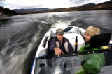Steve Paul (cq) drives his ski boat on Grand Lake with fellow resident Jane Kemp (cq) (in...