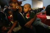 left to right, mom and her children, Golden, 1, Donnell, 3, and Mornell, 2, Patterson, sits in mom...