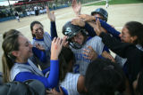 Pitcher for Pueblo Central Kayla Dionese is congratulated by her team mates after they defeated...