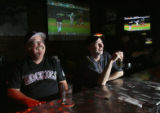 (from left) Don O'Brien (cq) and John Curlin (cq) watch the Yankees play Ohio at Jackson's Sports...
