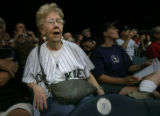 [ES0072] Colorado Rockies Lola Reinke (CQ), 82, of Denver, Colo., cheers on the Rockies from her...