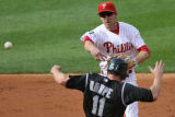 [ES0135]  Colorado Rockies' Brad Hawpe is out at second but   Philadelphia Phillies'  Chase Utley...