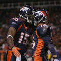 Denver Broncos Brandon Stokely, right, celebrates his first quarter touchdown with Brandon...