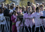 People lined up for the start of the co-ed 5k walk/run for the fifteenth annual Denver Susan G....