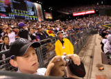 12 year-old  Jeffrey Gilstrap (cq) takes a picture of Matt Holiday, as the Rockies face...