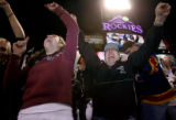(from left) 18 year-old Paige Sarnacki (cq), Mark Gannon (cq) and Dan Clark (cq) celebrate the...