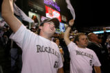 (from left) Eric Swanson (cq) and Matt Quinn (cq) celebrate the Rockies lead at the top of the 4th...