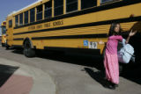 DM0015     A student at George E. Eiber Elementary waits to get on the bus at the end of the...