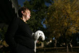 "Phyllis Rider (cq) holds her pet ""Zeter"" on her back porch of her Aurora home. Back in..."