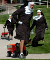 (SEPTEMBER 9, 2004- ENGLEWOOD, COLO.,) - Dressed in Sister costumes, St. Mary's Academy teachers,...