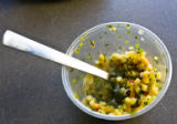 Behind the scenes in Rocky Mountain News photo studio leftover corn relish remains in a container....