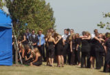 (BEATRICE, Nebraska, September10, 2004) Friends and family pay their respects at the graveside of...