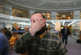 Tanner Mear (cq) from Denver gets  frustrated as he waits for the sales window to open on a...
