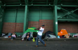 Boston Red Sox fan Derek Conrad (cq), 24, plays whiffle ball while camping out for tickets at ...