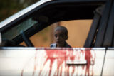 (NYT6) BAGHDAD, Iraq -- Oct. 9, 2007 -- IRAQ-1 -- A boy looks through the window of a car where...