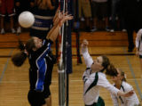 In the 2nd period Mountain Vista #11 Kimberly Burke hits it over the net with #1Leah Petersen...
