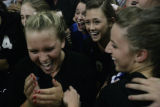 Highlands Ranch team celebrate after their win at class 5A Continental League volleyball at...