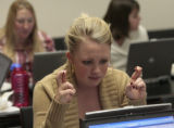 Emily Gore (cq) crosses her fingers while trying to buy Rockies tickets Tuesday afternoon, October...