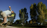 DM1842     Disc Golf players from Mile High Disc Golf play in Lakewood Gulch. The course opened in...
