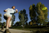 DM1843     Disc Golf players from Mile High Disc Golf play in Lakewood Gulch. The course opened in...