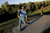 DM1845     Disc Golf players from Mile High Disc Golf play in Lakewood Gulch. The course opened in...