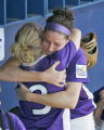 OKSO111 - Northwestern pitcher Eileen Canney, right, embraces teammate Julia Sears, left,...