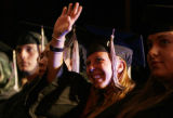 Kiersten Renee Lacey waves to family and friends during graduation ceremonies Sunday afternoon May...