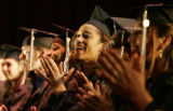 Rissah Fields (center, in focus) cheers during a speech by Jeannie L. Ritter, First Lady of the...
