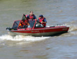 members of The Mesa County Ground Search Team searches the Colorado River near Palasade Colorado...