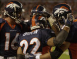 (DENVER, COLO., SEPTEMBER 12, 2004) - Denver Broncos' #22, Quinten Griffin, center, is...