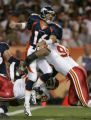 (DENVER, COLO., SEPTEMBER 12, 2004) - Denver Broncos' #16, Jake Plummer is hit by Kansas City...