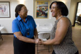 DLM2850  Denver City Council candidate Sharon Bailey, left, shakes hands with Adriane Sanford,...