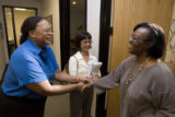 DLM2852  Denver City Council candidate Sharon Bailey, left, shakes hands with Michelle Rabouin,...