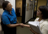 DLM2853  Denver City Council candidate Sharon Bailey, left, shakes hands with Lisa Phillips,...