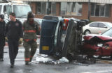 Denver Police and Fire investigate a two-car accident at 6th Avenue  and Kalamath Street Tuesday...