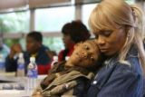 (from left) 3 year-old Jacob Elijah Bishop (cq) and his grandmother Teresa Lewis (cq) have a...