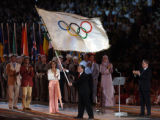 The mayor or Beijing waves the Wang Qishan waves the Olymic flag after ceremonially receiving it...