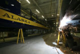 Walter Seegrist, cq, of Colorado Railcar Co. plant in Ft. Lupton, welds the brake system on a...