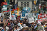 NEW YORK CITY, NY - AUGUST 29, 2004 -- Protestors march up Seventh Avenue in New York City Sunday,...