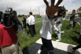 0177 Broncos wide reciever Rod Smith waves off the cameras after attending passing camp at Dove...