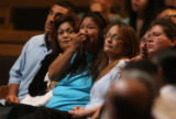 (from left) Shirley Ocariza (cq), Lori Ocariza (cq) and Linda Frayo (cq) share their loss at the...