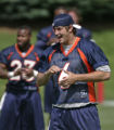 0127 Quarterback Jay Cutler joins the team as they stretch during a Denver Broncos passing camp at...