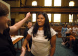 (DENVER, CO., MAY 19, 2004)  Veronica Solis, 20, right, shakes hands with Donna Campanella,...