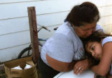 Rachel Ramos (cq), left, talks with her granddaughter Brooklyn Vargas (cq) as they take a break...