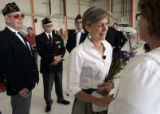 Colorado's First Lady Jeannie Ritter greets Lyne Wyatt (cq) who arranged to have a hero's welcome...