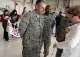 Lyne Wyatt (cq) talks with Maj. Gen. Michael Edwards (cq), the new commander of the Colorado...