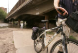 (JOE085) Bicyclist Jack Finch (cq) of Denver turns away from a flooded section of the bike path...