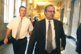 L to R: Eric Snell (cq) and his attorney Harvey Steinberg enter Denver District Court on Thursday...